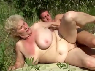 german granny public with young guy by troc